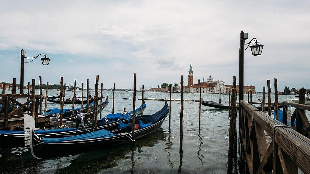 Gondolas line the waterfront in Venice, Italy