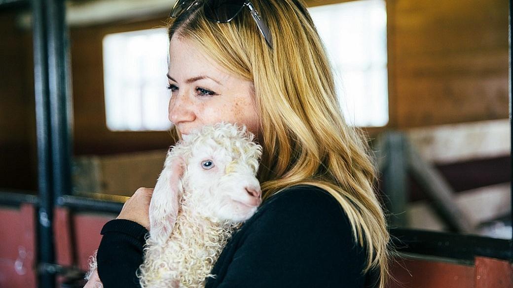 Juliana Dever goat snuggling Saguenay Quebec